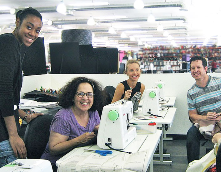 "Why are these people smiling? Because taking sewing classes at Mood LA is so much fun! (Aren't you glad we didn't write ""sew much fun""? We resisted the urge.)"