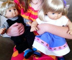 Bitty Twin dolls wearing clothes made with fabrics from Mood NYC.