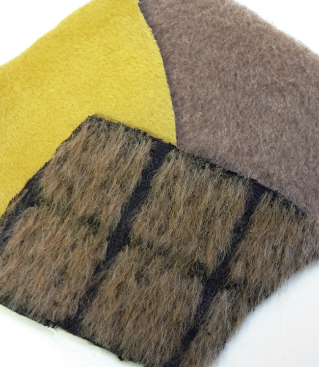 swatches of different alpaca fabrics available at Mood NYC.