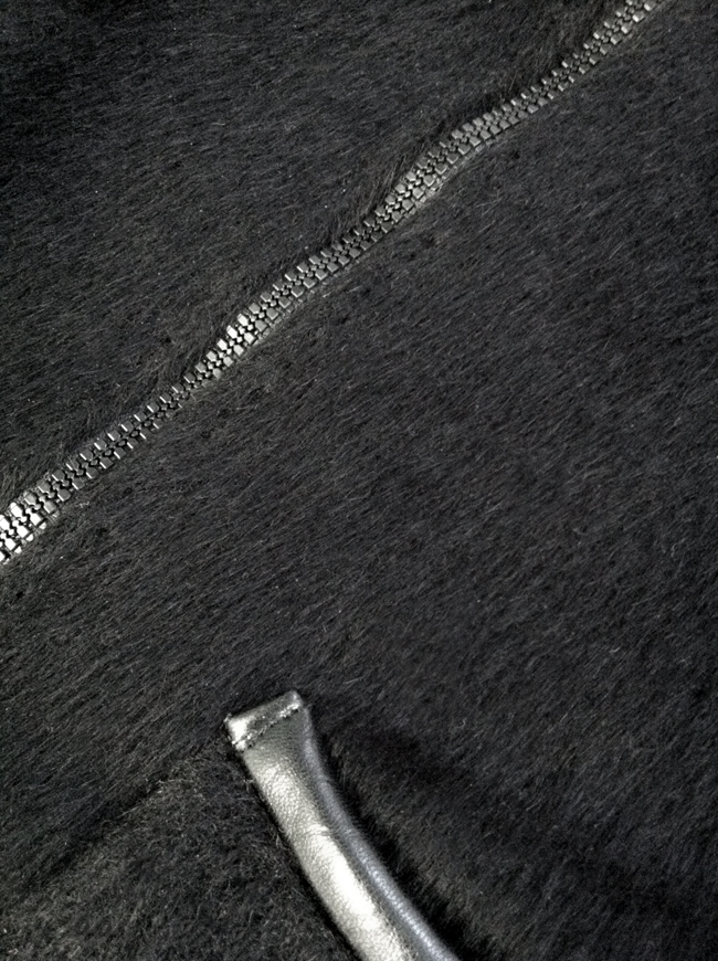 Detail of front-zip vest made with black alpaca from Mood Fabrics NYC.