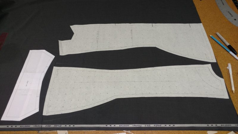Cut the front and back out of two layers of suiting. The collar is shown for layout purposes, but you only need to cut one. The chalk lines are alterations to the pattern after doing the mockup.