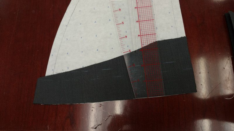 """Use the ruler to mark a slightly curved 2"""" strip. It's okay if bits are missing, as long as nothing goes past the seam allowance."""