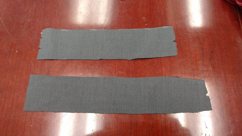 Two notches for the center back seam, one notch for attaching to the sides. You can also use chalk to write what each piece is on the reverse of the fabric.