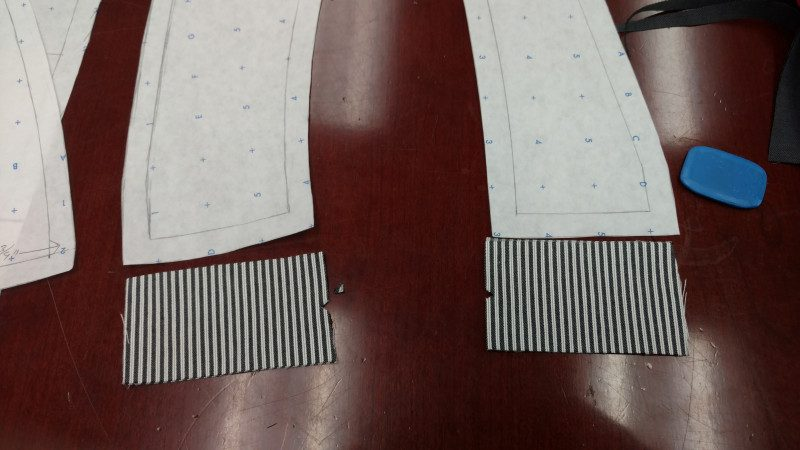 Do the same with the side pieces. The notch is to match the ones on the back and front pieces, while the plain is for the side seams.