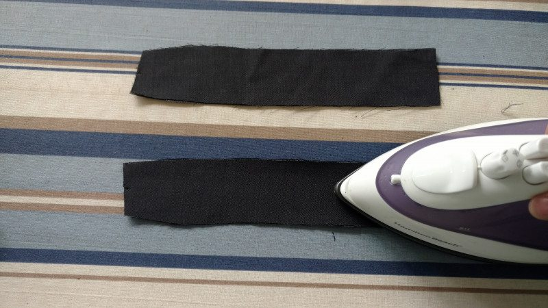 Use the iron to attach fusible interfacing to the wrong side of the facings. Medium to heavy weight suiting doesn't need interfacing.