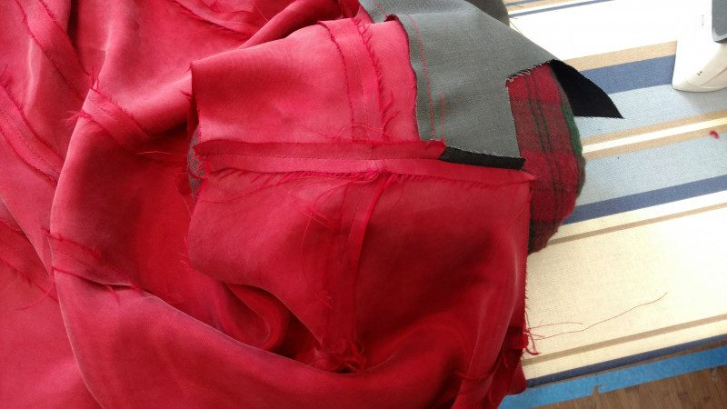 The uneven ends will be hidden in the seam allowance at the armscye and neck edge.