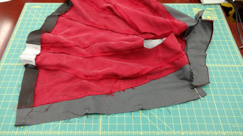 Start at the neck edge, go around the lapels, down the front, across the hem, and back up the other side to the neck edge.