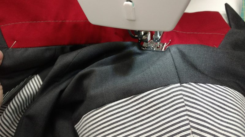 Stitching in the ditch will keep the neck edge seams on the lining and fashion layer aligned.