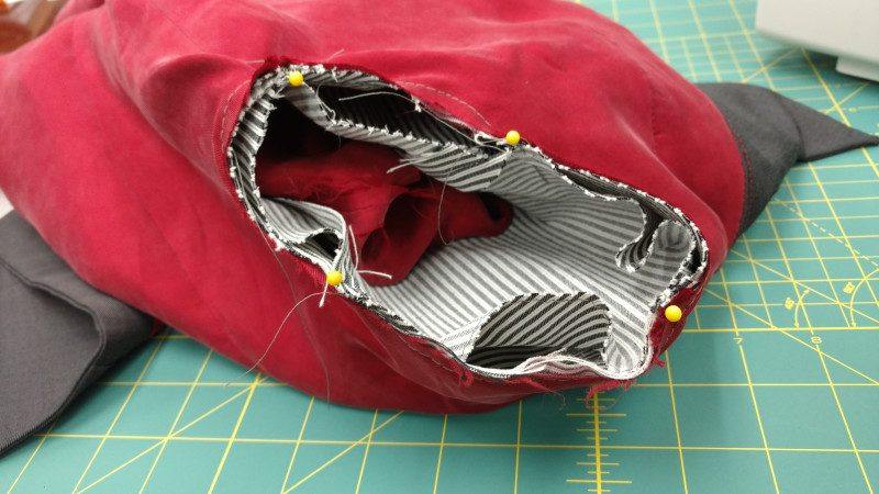 The bottom of the armscye curve should match the bottom of the sleeve head. The top of the sleeve head will be bigger.